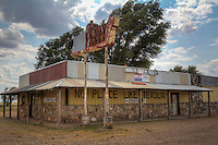 Bar in Texoal Oklahoma which is a Route 66 ghost town on the border of Oklahoma and Texas.  There are still a few people living here, however most of the town consists of abondoned homes and buildings.