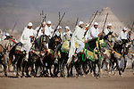 During the Fantasia Festival that celebrates the end of the harvest, men will attempt to fire their rifles in unison during the race, Beni Mellal, Morocco.