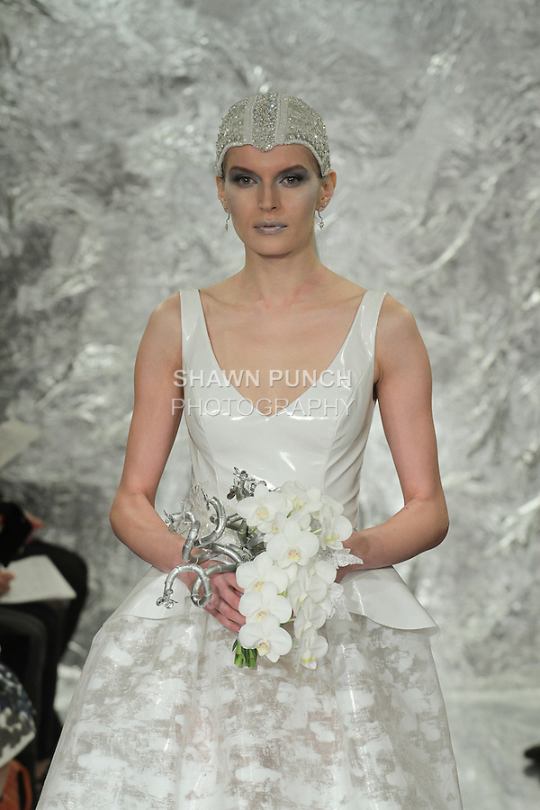 Model Irina Kondratyeva walks runway in Amidala - a pigmented printed plasticized nylon ball gown with white vinyl bodice and peplum, from the Theia Spring 2017 bridal collection by Don O'Neill, during New York Bridal Fashion Week Spring Summer 2017 on April 14, 2016.