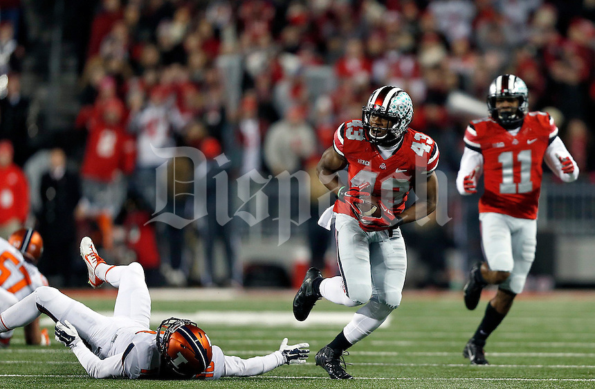 Ohio State Buckeyes linebacker Darron Lee (43) gets away from Illinois Fighting Illini wide receiver Mike Dudek (18) after his interception in the first quarter of the NCAA football game at Ohio Stadium on Saturday, November 1, 2014. (Columbus Dispatch photo by Jonathan Quilter)