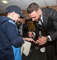 Max Muller of Wycombe Wanderers signs an autograph for a young supporter during the Sky Bet League 2 match between Wycombe Wanderers and Crawley Town at Adams Park, High Wycombe, England on 25 February 2017. Photo by Andy Rowland / PRiME Media Images.