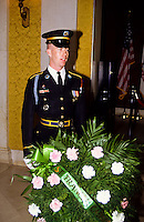 Guard with flower decoration in Arlington cemetery in Washington DC, USA