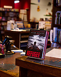 July 26, 2017. Raleigh, North Carolina.<br /> <br /> Copies of &quot;Refugee&quot; were displayed at the check out of Quail Ridge Books. <br /> <br /> Author Alan Gratz spoke about and signed his new book &quot;Refugee&quot; at Quail Ridge Books. The young adult fiction novel contrasts the stories of three refugees from different time periods, a Jewish boy in 1930's Germany , a Cuban girl in 1994 and a Syrian boy in 2015.