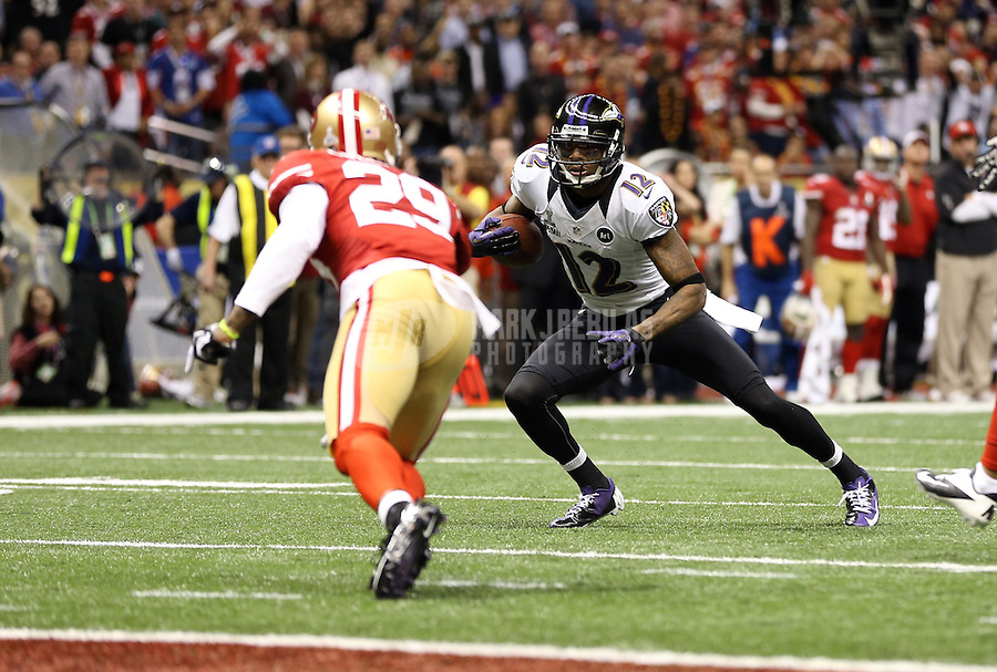 Feb 3, 2013; New Orleans, LA, USA; Baltimore Ravens wide receiver Jacoby Jones (12) runs against San Francisco 49ers defensive back Chris Culliver (29) and scores a touchdown in the second quarter in Super Bowl XLVII at the Mercedes-Benz Superdome. Mandatory Credit: Mark J. Rebilas-