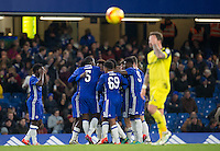 Kurt Zouma (5) of Chelsea celebrates with teammates as Josimar Quintero of Chelsea puts them in front during the The Checkatrade Trophy match between Chelsea U23 and Oxford United at Stamford Bridge, London, England on 8 November 2016. Photo by Andy Rowland.