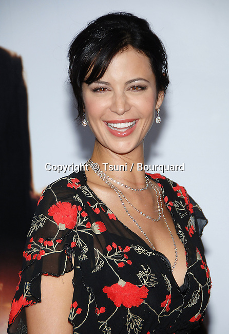 Catherine Bell  arriving at the PURSUIT of Happiness Premiere at the Westwood Village Theatre In Los Angeles.<br /> <br /> headshot<br /> eye contact<br /> smile