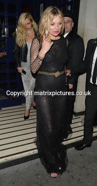 NON EXCLUSIVE PICTURE: MATRIXPICTURES.CO.UK<br /> PLEASE CREDIT ALL USES<br /> <br /> WORLD RIGHTS<br /> <br /> English model Kate Moss is pictured as she leaves Tramp Club after a big night out following the Vogue 100 dinner in London.<br /> <br /> The supermodel wears an elegant black dress with sequin polka dots.<br /> <br /> MAY 23rd 2016<br /> <br /> REF: LTN 161526