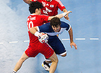 06 APR 2012 - LONDON, GBR - Gonzalo Carou (ARG) (in blue and white) dives past South Korea's Chan Yong Park (#10, in red) during their men's 2012 London Cup match at the National Sports Centre in Crystal Palace, Great Britain (PHOTO (C) 2012 NIGEL FARROW)