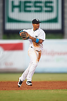 Tampa Yankees shortstop Gleyber Torres (11) throws to first during a game against the Daytona Tortugas on August 5, 2016 at George M. Steinbrenner Field in Tampa, Florida.  Tampa defeated Daytona 7-1.  (Mike Janes/Four Seam Images)