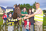 Liam Musgrave making the presentation to the Moriarty Family from Caragh Lake, Winners of the Local Plate l-r; Jockey Keith, Albert, Daragh & Valerie Moriarty.