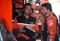 May 2, 2008; Richmond, VA, USA; NASCAR Sprint Cup Series driver Tony Stewart (right) talks with crew chief Greg Zipadelli during practice for the Dan Lowry 400 at the Richmond International Raceway. Mandatory Credit: Mark J. Rebilas-US PRESSWIRE