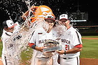 Ryan Mountcastle (5) and coach Sean Casey (21) have the water bucket dumped over their heads by Sati Santa Cruz and Kody Clemens (hidden) at the MVP award presentation after the Under Armour All-American Game on August 16, 2014 at Wrigley Field in Chicago, Illinois. (Mike Janes/Four Seam Images)