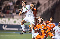 HEMPSTEAD, NY – OCTOBER 12: The New York Cosmos and Carolina RailHawks battle for an aerial ball during an NASL match on October 12, 2013 at  Shuart Stadium in Hempstead, New York.