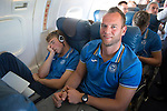 St Johnstone v FC Minsk...31.07.13<br /> Keeper Alan Mannus on the flight over to Grodno in Belarus where St Johnstone will play FC Minsk on Thursday, he is pictured next to a sleeping David Wotherspoon.<br /> Picture by Graeme Hart.<br /> Copyright Perthshire Picture Agency<br /> Tel: 01738 623350  Mobile: 07990 594431