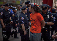 An Occupy Wall Street member is detained by NYPD officers during a weekly march called by every friday on Wall Street in New York, United States. 23/03/2012.  Photo by Eduardo Munoz Alvarez / VIEWpress.