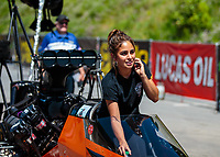 Jun 16, 2018; Bristol, TN, USA; Jasmine Salinas, crew member for NHRA top fuel driver Mike Salinas during qualifying for the Thunder Valley Nationals at Bristol Dragway. Mandatory Credit: Mark J. Rebilas-USA TODAY Sports