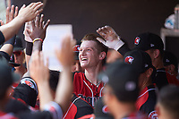 Sam Huff (24) of the Hickory Crawdads high fives his teammates after hitting a home run against the Lakewood BlueClaws at L.P. Frans Stadium on April 28, 2019 in Hickory, North Carolina. The Crawdads defeated the BlueClaws 10-3. (Brian Westerholt/Four Seam Images)