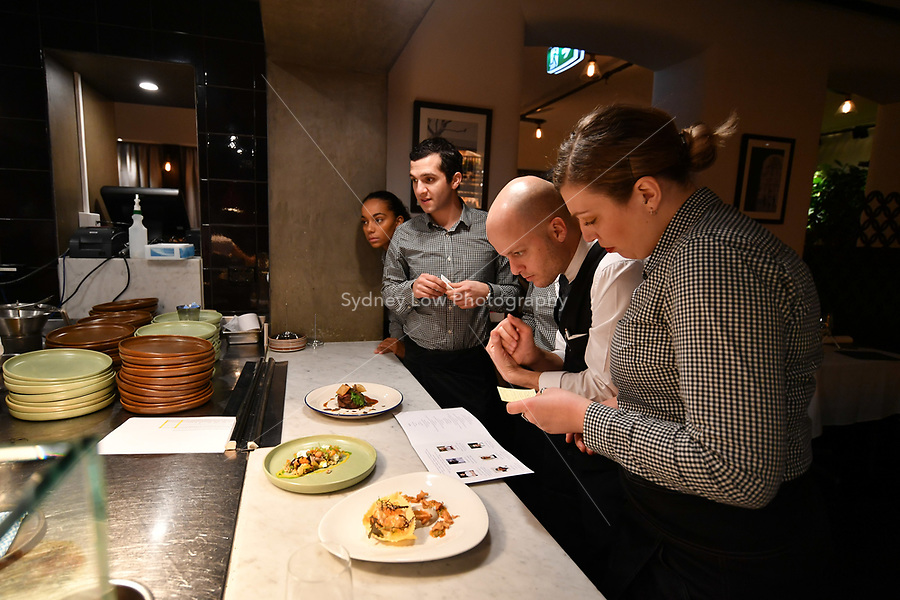 MELBOURNE, 30 June 2017 – Waiters prepare for a dinner celebrating Philippe Mouchel's 25 years in Australia with six chefs who worked with him in the past at Philippe Restaurant in Melbourne, Australia.