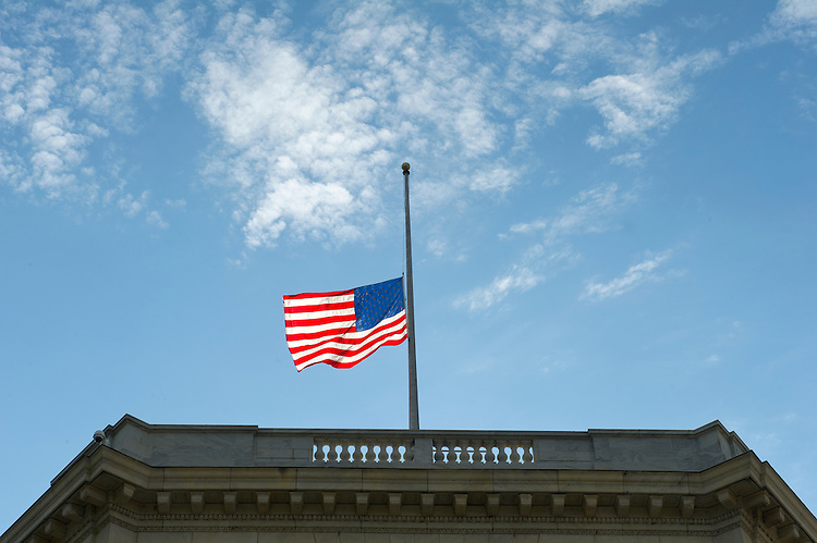 UNITED STATES - Oct 22: The flag flies at half-staff at the Cannon House Office Building in Washington, D.C. to pay tribute to the victims of the Nevada school shooting's Tuesday October 22, 2013. (Photo By Douglas Graham/CQ Roll Call)