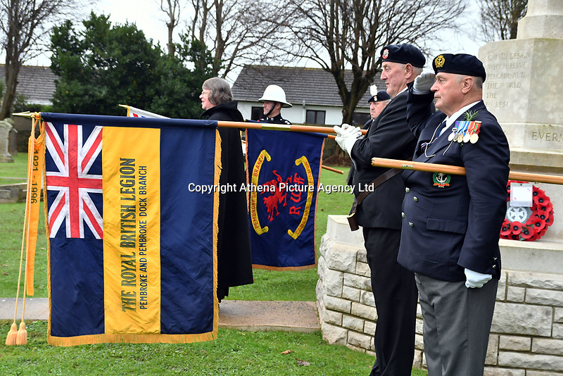 Pictured: Former members of the Armed Forces observe two minutes silence. Saturday 11 November 2017<br /> Re: Armistice Day, two minutes were observed to mark remembrance at Pembroke Dock Military cemetery, west Wales, UK.