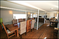 BNPS.co.uk (01202 558833)<br /> Pic: RiverSales&amp;Lettings/BNPS<br /> <br /> ****Please use full byline****<br /> <br /> Dining room.<br /> <br /> A 100-year-old barge once used to ship cargo up and down the River Thames has been transformed into a plush four-bedroom house that is now on the market for &pound;450,000.<br /> <br /> The 90ft boat was salvaged from the banks of Thames in the 1970s and turned into a floating dormitory for schoolchildren at an outdoor activity centre.<br /> <br /> But it has since been given a complete makeover and now looks more like a cosy country cottage than a boat.<br /> <br /> The two-storey houseboat runs off mains electricity, has wifi access, electric heating, and hot water, and it also has a reserve water tank stored in its funnel.<br /> <br /> And buyers can count the picturesque River Hamble near Southampton, Hants, as their back garden.