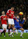 Chris Smalling of Manchester United holds off Eden Hazard of Chelsea to head the ball - English Premier League - Manchester Utd vs Chelsea - Old Trafford Stadium - Manchester - England - 28th December 2015 - Picture Simon Bellis/Sportimage