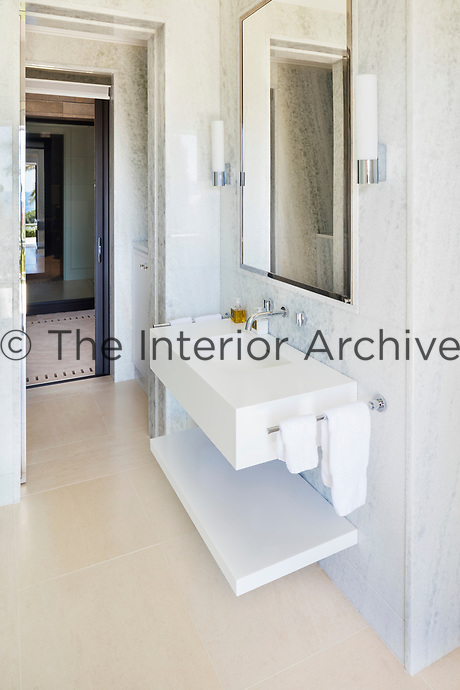 The bathroom is of a classic contemporary design scheme, which emphasises pale muted colours and simple architectural forms.