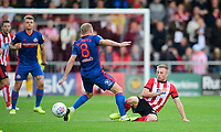 Sunderland's Dylan McGeouch is tackled by Lincoln City's Joe Morrell<br /> <br /> Photographer Chris Vaughan/CameraSport<br /> <br /> The EFL Sky Bet League One - Lincoln City v Sunderland - Saturday 5th October 2019 - Sincil Bank - Lincoln<br /> <br /> World Copyright © 2019 CameraSport. All rights reserved. 43 Linden Ave. Countesthorpe. Leicester. England. LE8 5PG - Tel: +44 (0) 116 277 4147 - admin@camerasport.com - www.camerasport.com