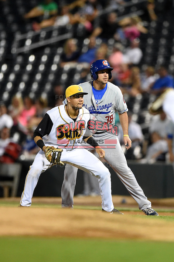 Chattanooga Lookouts pinch hitter Alex Liddi (38) leads off first behind first baseman Viosergy Rosa (44) during game three of the Southern League Championship Series against the Jacksonville Suns on September 12, 2014 at Bragan Field in Jacksonville, Florida.  Jacksonville defeated Chattanooga 6-1 to sweep three games to none.  (Mike Janes/Four Seam Images)