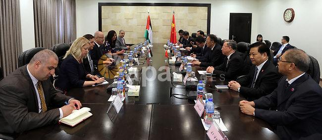 Palestinian Prime Minister, Rami Hamdallah, meets with Vice chairman of the Standing Committee of the National People's Congress (NPC) Kiang Bunkog, in the West bank city of Ramallah, on July 12, 2017. Photo by Prime Minister Office