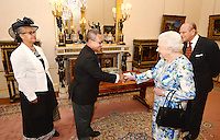 10 June 2016 - London, England - Sir Iakoba Italeli of Tuvalu shakes hands with Queen Elizabeth II as Prince Philip Duke of Edinburgh looks on ahead of the Governor General's lunch at Buckingham Palace in London. Photo Credit: ALPR/AdMedia