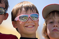 The large crowd in attendance on Education Day is reflected in the sunglasses worn by Winecoff Elementary School 5th grader Alex Rodriguez at Fieldcrest Cannon Stadium June 2, 2009 in Kannapolis, North Carolina. (Photo by Brian Westerholt / Four Seam Images)
