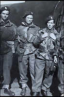 BNPS.co.uk (01202 558833)<br /> Pic: Bellmans/BNPS<br /> <br /> Lance Corporal William James Cooke (middle).<br /> <br /> A fascinating trove of SAS records including some of the first photographs of the elite force which have never been seen before has been unearthed. <br /> <br /> The extensive assortment, also including medals and documents, was accumulated by war hero Lance Corporal William James Cooke at the end of World War Two. <br /> <br /> Remarkable images of Cooke's previously unrevealed wartime exploits show him serving behind enemy lines in occupied France and assisting with the liberation of Norway. <br /> <br /> His accomplishments have come to light after a family member presented the bequeathed collection to Hampshire-based auctioneer Bellmans, which will sell it tomorrow.