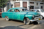 HAVANA - DECEMBER 29: A vintage car in Havana, Cuba.  Legislation passed in 2011 has legalized car sales to all Cuban citizens who were previously restricted to owning pre-revolution vehicles.