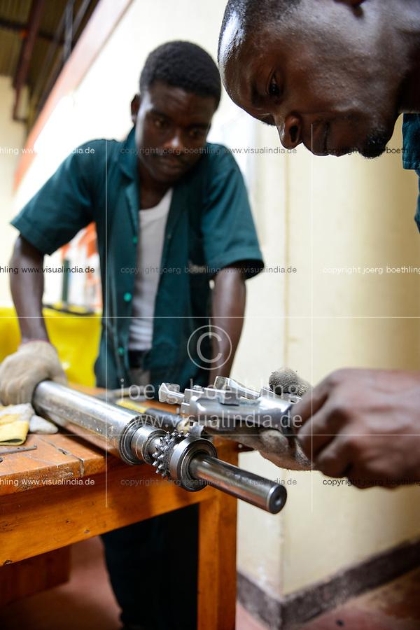 RWANDA, Kigali, plastic recycling at company Ecoplastics, mechanic repair machine parts