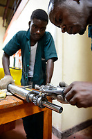 RWANDA, Kigali, plastic recycling at company Ecoplastics, mechanic repair machine parts