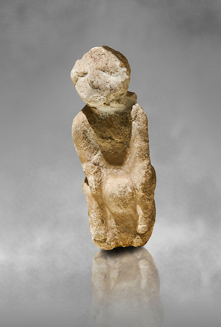 Seated marble goddess. Catalhoyuk Collections. Museum of Anatolian Civilisations, Ankara. Catalhoyuk Collections. Museum of Anatolian Civilisations, Ankara. Against a gray mottled background