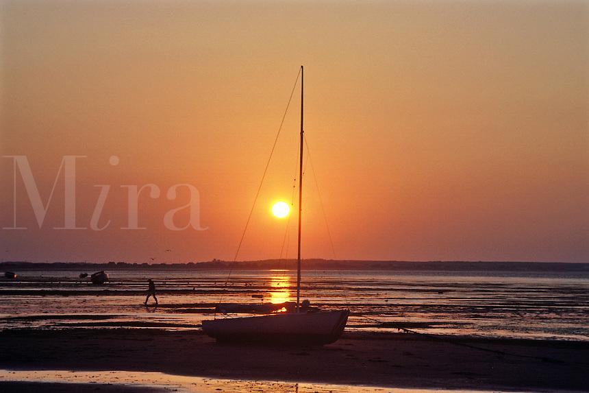 Cape Cod sunrise. Cape Cod Bay and Boat sunrise. Solo boat sunrise.