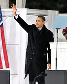 "Washington, DC - January 18, 2009 -- United States President-elect Barack Obama waves as he prepares to make remarks during the performance at the ""Today: We are One - The Obama Inaugural Celebration at the Lincoln Memorial"" in Washington, D.C. on Sunday, January 18, 2009..Credit: Ron Sachs / CNP.(RESTRICTION: NO New York or New Jersey Newspapers or newspapers within a 75 mile radius of New York City)"