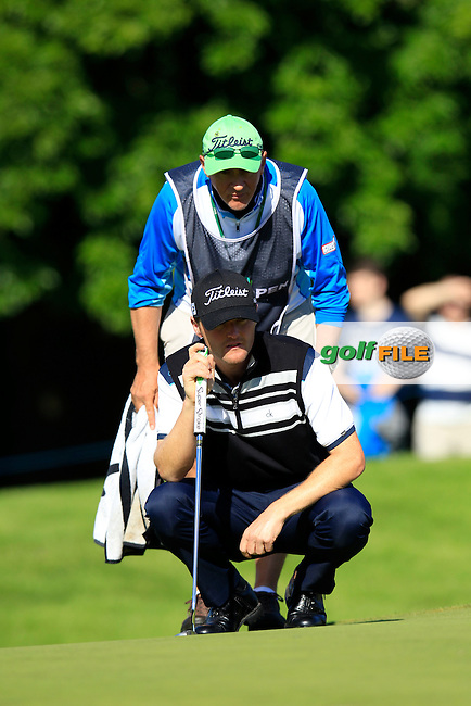 Michael Hoey (NIR) and caddy Gerry on the 16th green during Friday's Round 2 of the 2014 Irish Open held at Fota Island Resort, Cork, Ireland. 20th June 2014.<br /> Picture: Eoin Clarke www.golffile.ie