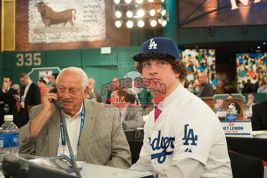 Pitcher Grant Holmes (Conway H.S. (SC)) the number 22 overall pick to the Los Angeles Dodgers with Hall of Famer Tommy Lasorda during the MLB Draft on Thursday June 05,2014 at Studio 42 in Secaucus, NJ.   (Tomasso DeRosa/ Four Seam Images)