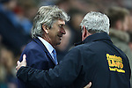 \Manuel Pellegrini, manager of Manchester City greets Hull's manager, Steve Bruce - Manchester City vs Hull City - Capital One Cup - Etihad Stadium - Manchester - 29/12/2015 Pic Philip Oldham/SportImage