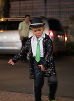 A young street performer at night in the streets of saigon performing a Michael Jackson act.<br />