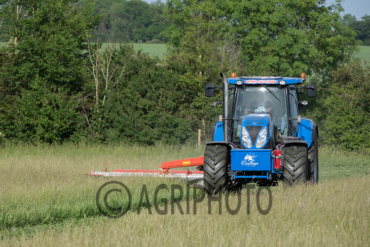 26.5.2020 Mowing grass for silage to feed the Lincoln Red herd of cattle over Winter at Bowthorpe Park, Lincolnshire <br /> ©Tim Scrivener Photographer 07850 303986<br />      ....Covering Agriculture In The UK....