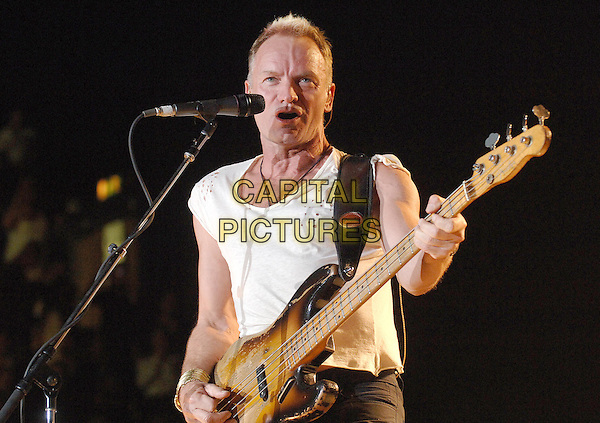 STING .The Police perfoming at Wembley Arena..20th October 2007 London, England.half length on stage concert live show gig performance music singing guitar white top .CAP/ BEL.©Tom Belcher/Capital Pictures.