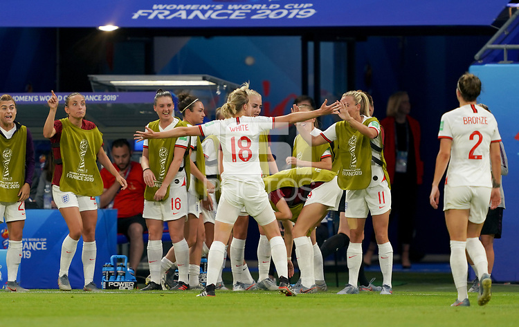 DECINES-CHARPIEU, FRANCE - JULY 02: Ellen White #18 scores and celebrates with her team mates during a 2019 FIFA Women's World Cup France Semi-Final match between England and the United States at Groupama Stadium on July 02, 2019 in Decines-Charpieu, France.