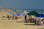 Crowded sand beach full of people in summer, Carlsbad State Beach, San Diego County, California