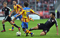 19.09.2012. Munich, Germany.  Munichs Claudio Pizarro (R) and Andres Guardado of Valencia challenge for the ball during the UEFA Champions League group F soccer match between Bayern Munich and Valencia CF at the football  Arena M in Munich, Germany, 19 September 2012.