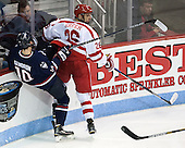 Miles Gendron (UConn - 10), A.J. Greer (BU - 26) - The Boston University Terriers defeated the visiting University of Connecticut Huskies 4-2 (EN) on Saturday, October 24, 2015, at Agganis Arena in Boston, Massachusetts.