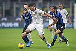 Alberto Cerri of Cagliari holds off the attentions of Marcelo Brozovic and Diego Godin of Inter during the Coppa Italia match at Giuseppe Meazza, Milan. Picture date: 14th January 2020. Picture credit should read: Jonathan Moscrop/Sportimage